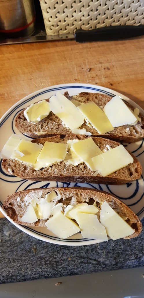 A plate of rye bread and cheese.